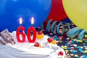 60th birthday cake with candles