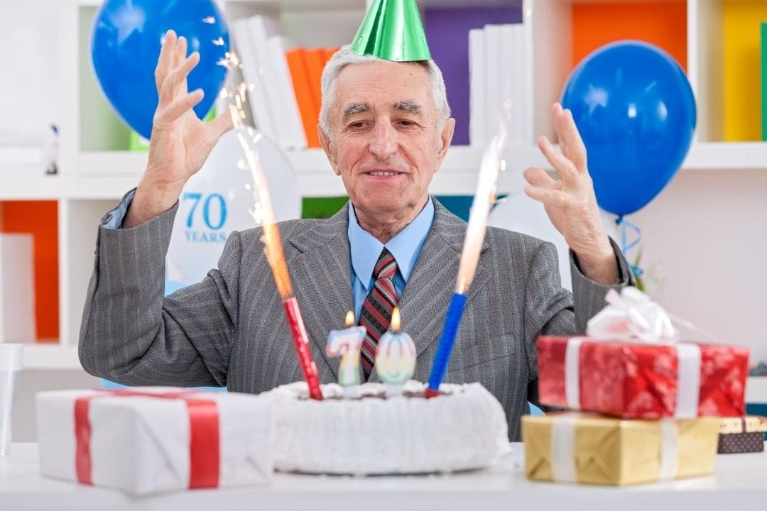 man with his 70th birthday cake