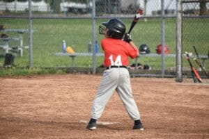 8 years old boy playing baseball