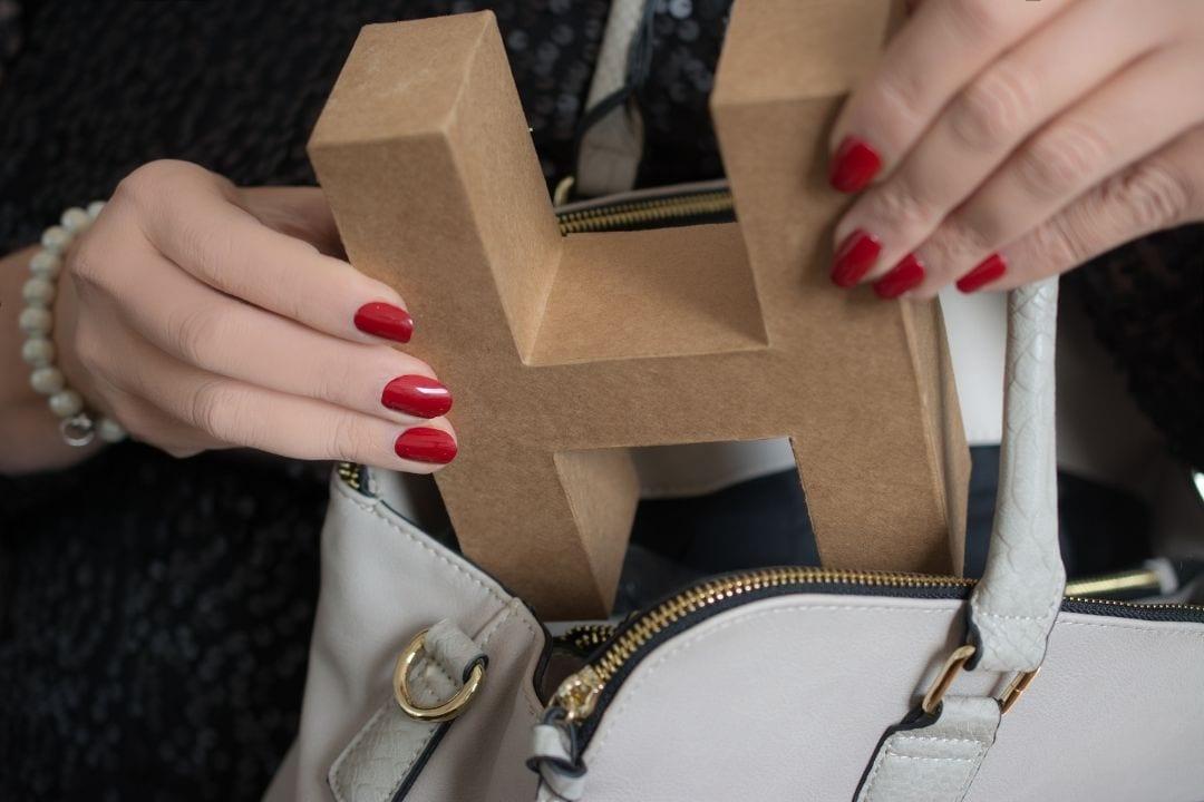 GIANT h letter in a handbag