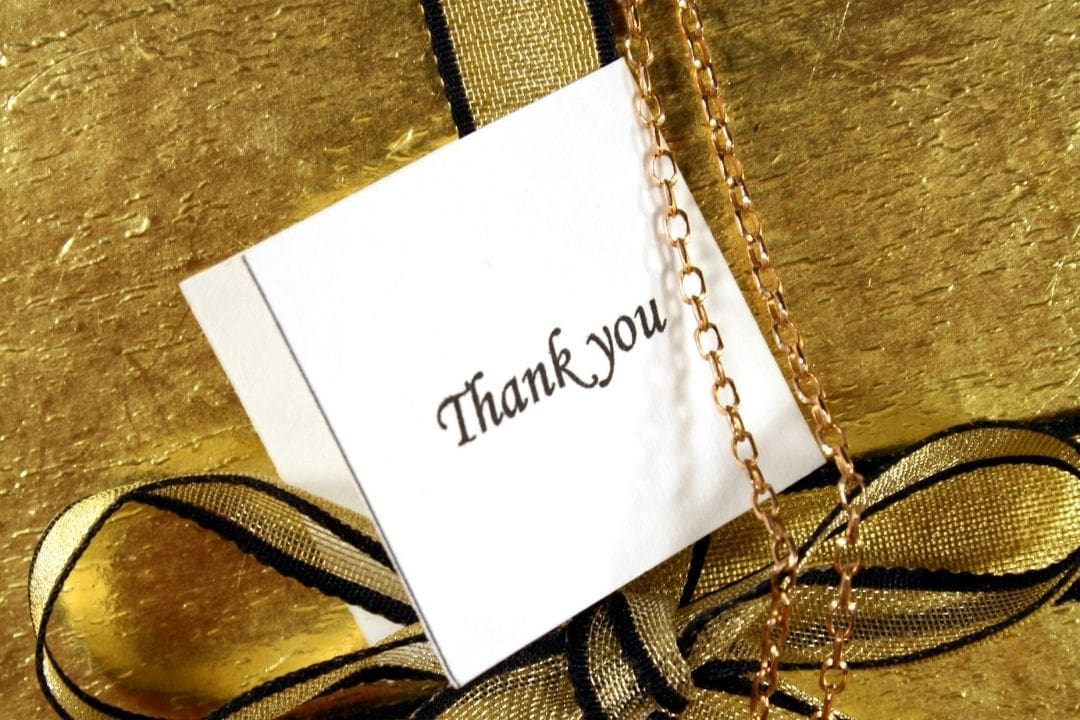 present with a thank you note