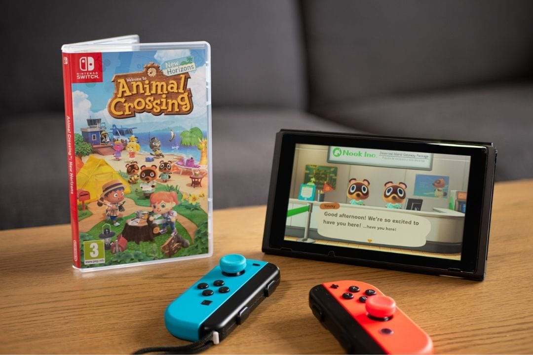animal crossing game next to nintendo switch console