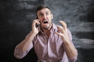 anxious angry guy on the phone