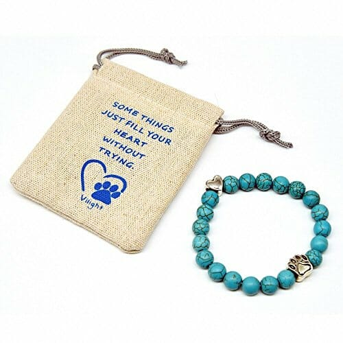 blue beads bracelet with a white gift bag
