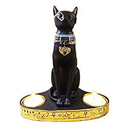 cat statue with candle holder