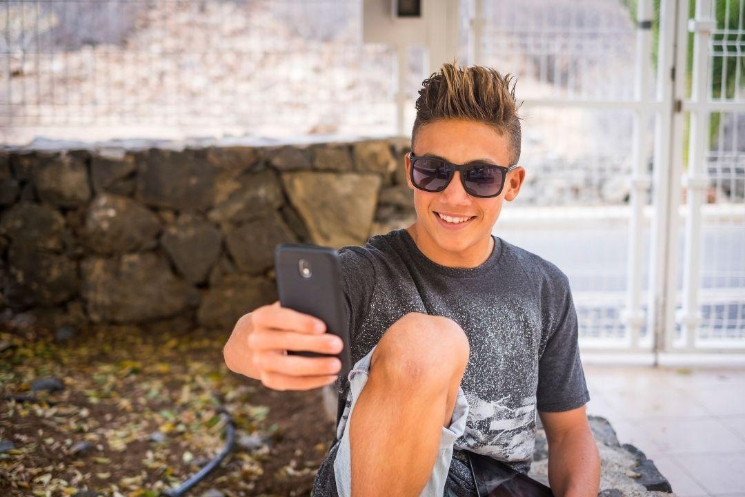 fifteen years old guy taking a selfie