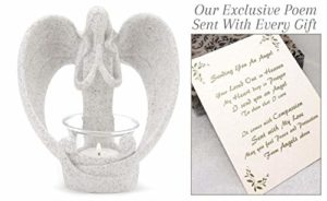 angel figurine holding a candle