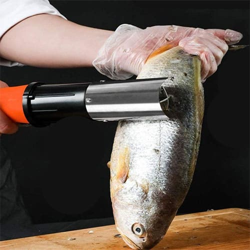 cook skinning a fish