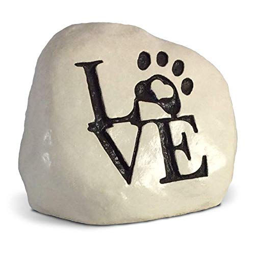 stone with a paw on it and written the word love