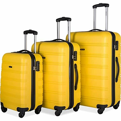 three size yellow suitcases