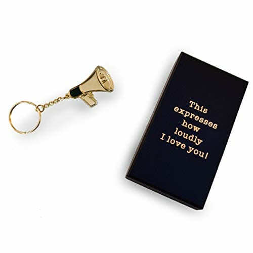 golden keychain in the shape of a megaphone