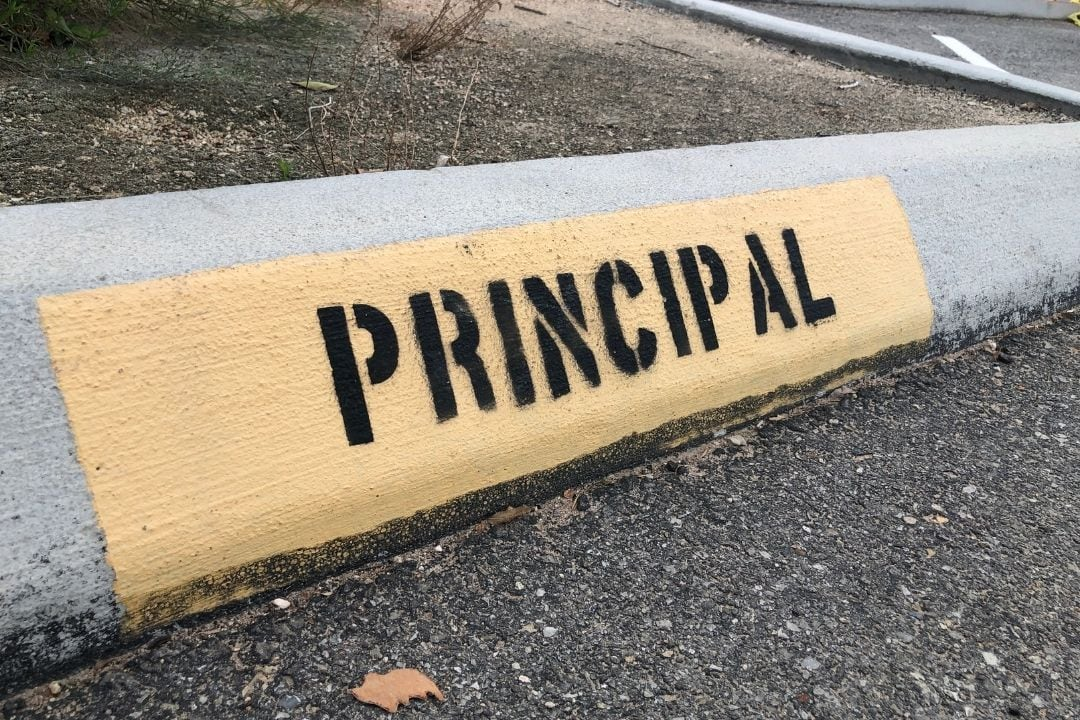 school principal car parking space sign