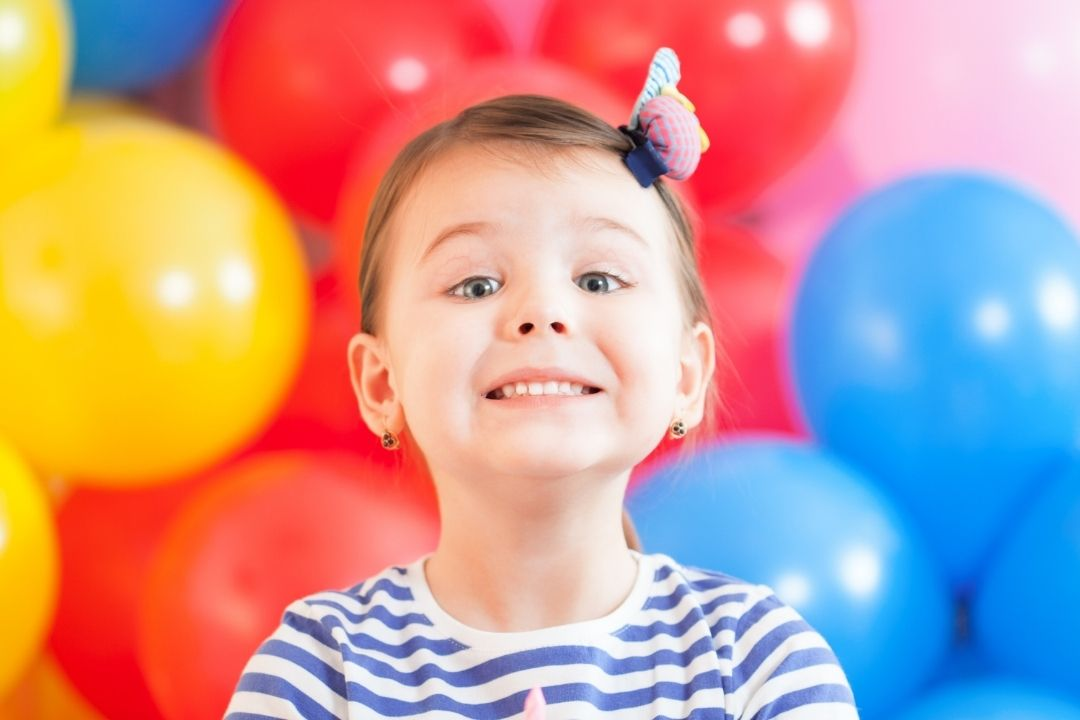 three years old girl at her birthday party