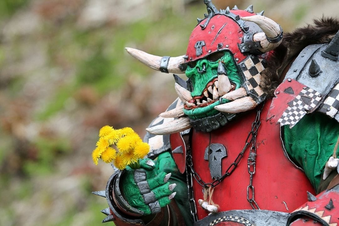 warcraft monster giving a flower as a present