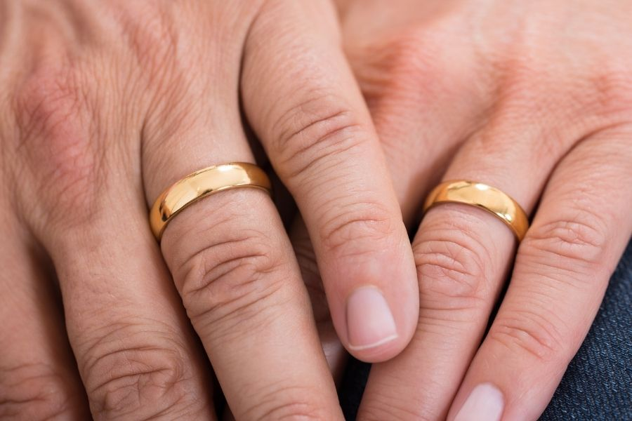 parents hands with wedding rings